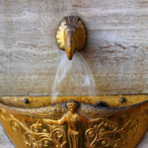 outdoor fountain in gold color decorated with an elegant oriental style ornament